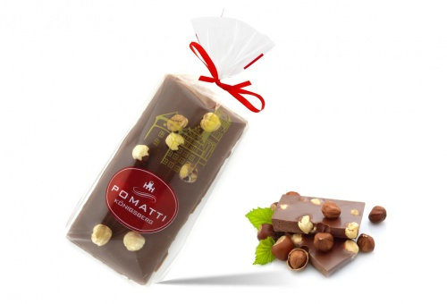 Marzipan in milk chocolate with hazelnuts